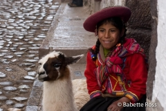 Woman in Traditional Dress with a Llama