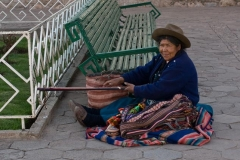 Woman in Traditional Dress Weaving in San Blas
