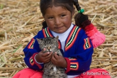 Uros Little Girl in Traditional Dress with a Kitten