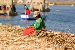 Uros Woman in Traditional Dress and Tortora Reed Huts