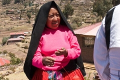 Taquile Woman in Traditional Dress Spinning Yarn